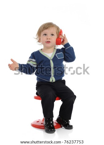 Cute little child speaking on the cell phone. isolated