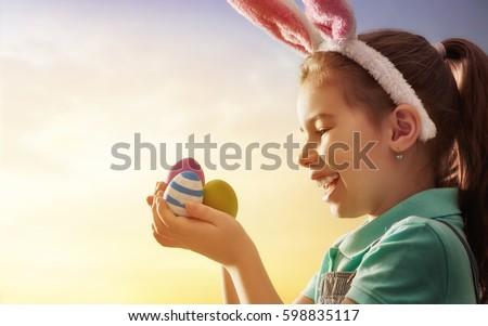 cute little child wearing bunny ...