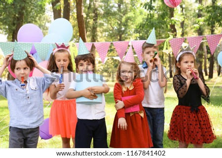 Cute little children at birthday party outdoors #1167841402