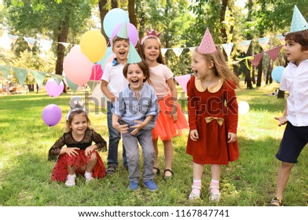 Cute little children at birthday party outdoors #1167847741