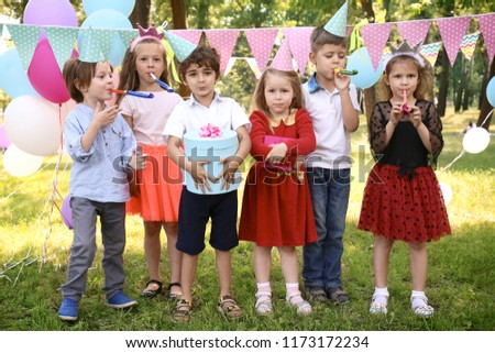 Cute little children at birthday party outdoors #1173172234