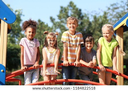Cute little children having fun on playground outdoors #1184822518