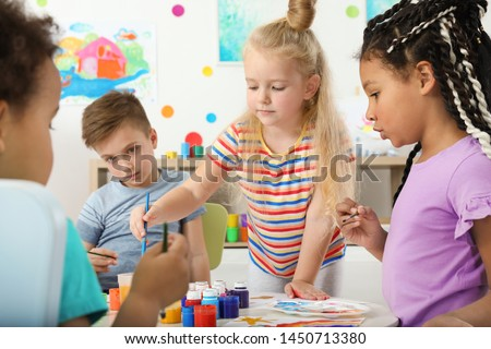 Cute little children painting at lesson indoors Stock photo ©