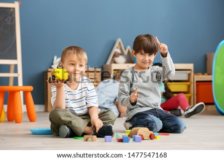 Cute little children playing in kindergarten #1477547168