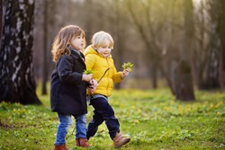Cute little children playing together. Preschooler boy and girl. Best friends.Toddler siblings together on nature. Kids in sunny spring park