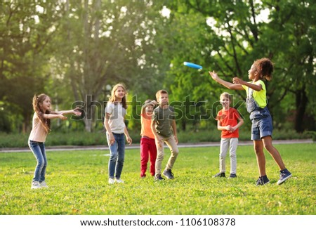 Cute little children playing with frisbee outdoors on sunny day
