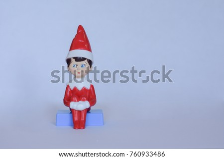cute little elf sitting on blue ...