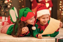 Cute little elves with letter to Santa at home
