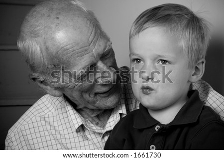 ... Little Four Year-Old Boy Sitting On Grandpa'S Lap. Stock Photo