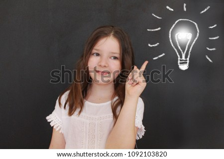 Cute little girl and light bulb drawing