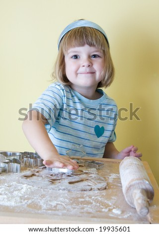 cute, little girl baking Christmas gingerbread