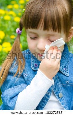 Cute little girl crying outdoors