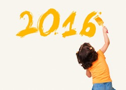 Cute little girl drawing new year 2016 with painting brush on wall background