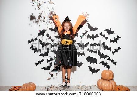 cute little girl dressed in...