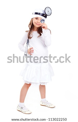 Cute little girl dressed like a doctor looking at camera with a cheerful smile