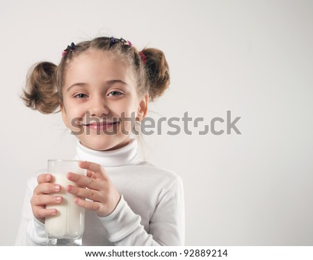 Cute little girl drinks milk