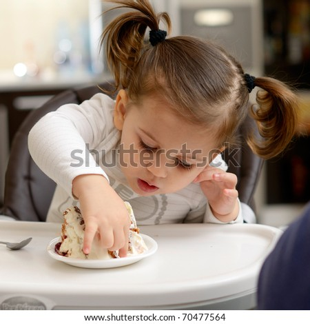 Cute Little Girl Eating Cake Stock Photo 70477564 : Shutterstock
