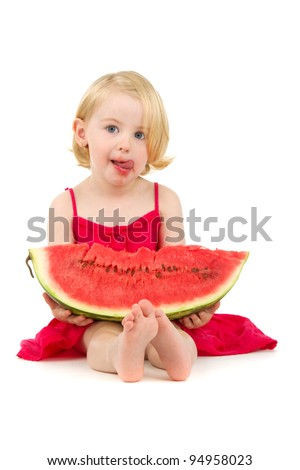 cute little girl eating watermelon on white background