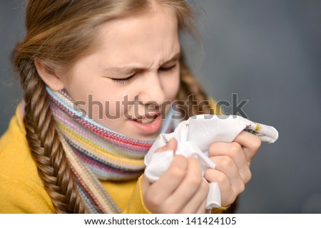 cute little girl getting the flu - stock photo