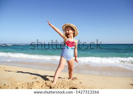Cute little girl having fun at the beach on familly vacation. Familly, vacation, summer concept.