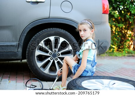 Young girl changing in car