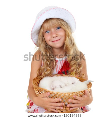 Cute little girl holding a basket with little cats isolated on white background