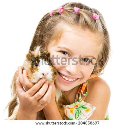 Cute little girl holding a guinea pig Isolated on white background