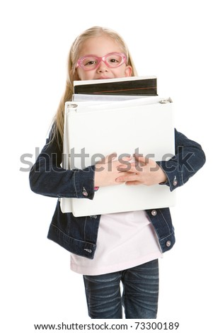 Cute little girl holding books isolated on white background