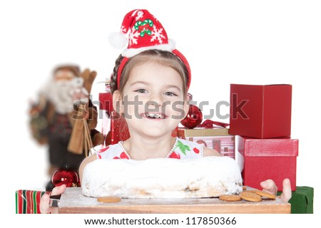 Cute little girl holding Christmas cake with powdered sugar over white