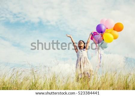 cute little girl holding...