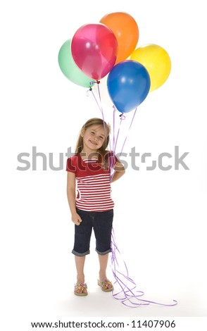 Cute little girl holding colorful balloons on a white background