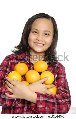 cute Little girl holding orange