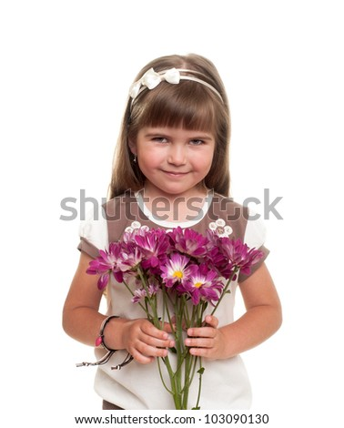 cute little girl holding the bunch of flowers and smiling against white background