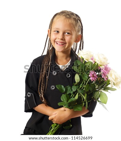 cute little girl in a school jacket with a bouquet of flowers
