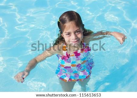 Cute little Girl in a swimming pool