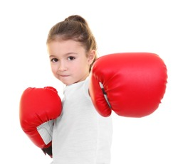 Cute little girl in boxing gloves on white background
