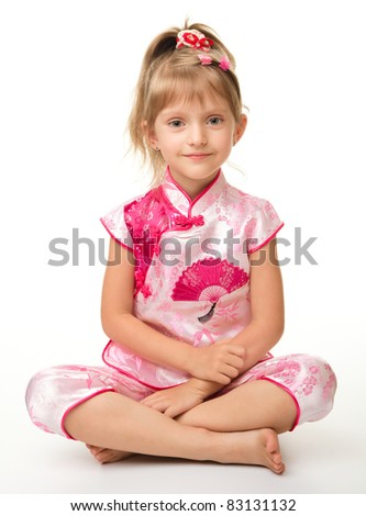 Cute little girl in pink ba ba shirt (Vietnamese), isolated over white