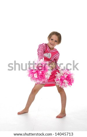 cute little girl in pink cheering outfit and pom poms