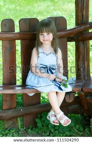Cute little girl in summer day