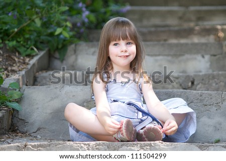Cute little girl in summer day