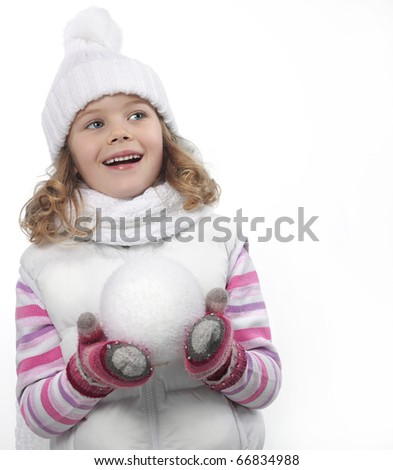 cute little girl in warm clothes on white background with snowball
