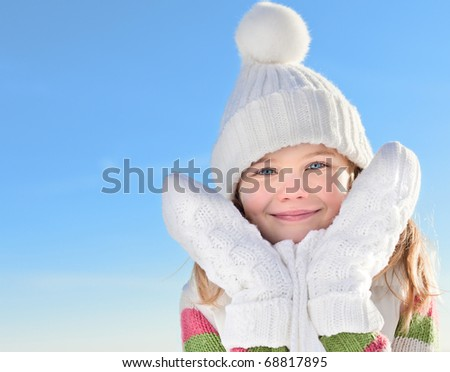 cute little girl in warm clothes outdoors