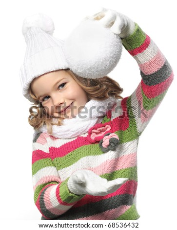 cute little girl in warm clothes with snowball on white background