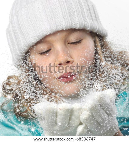 cute little girl in warm hat and gloves blowing snow on white background