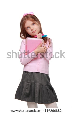 Cute little girl is holding a light pink copy-book isolated on white background on Education theme concept/Female little girl is wearing modern clothes on Beauty and Fashion theme