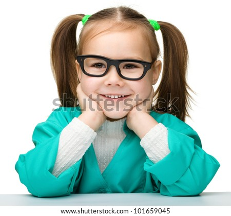 Cute little girl is playing doctor, isolated over white