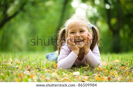 cute little girl is playing...