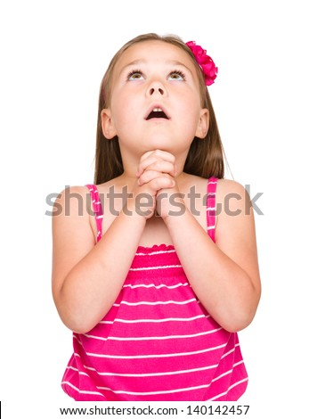Cute little girl is praying, isolated over white - stock photo
