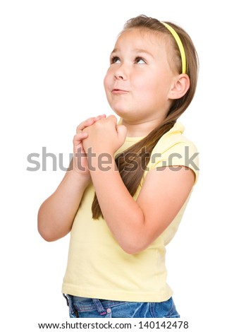 Cute little girl is praying, isolated over white