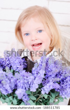 Cute little girl laughing, holding flowers #188511785